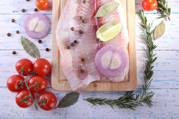 Pangasius fillet with herb, spices and vegetables