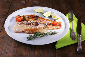 Dish of Pangasius fillet with spices and vegetables