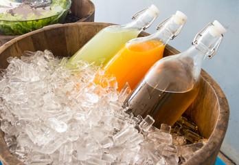bottles of juice on ice