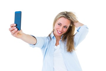 Pretty blonde taking a selfie with smartphone
