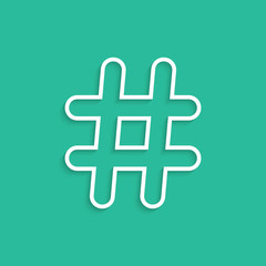 white hashtag icon isolated on green background