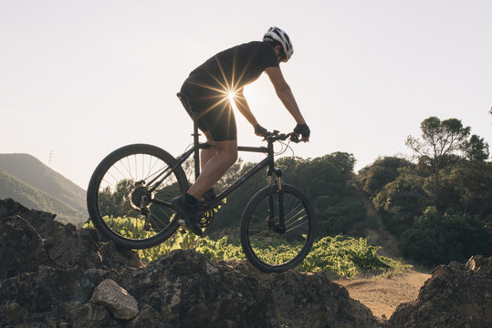 The young man cycling Cross-country