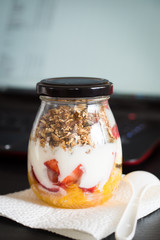 Granola with Fruits and Yogurt Ready to Take to Work as a Snack