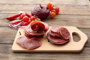 Wall Mural - Sliced salami with chili pepper, cherry tomatoes, onion and