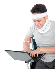 injured young man in wheelchair work on laptop