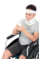 injured young man play on his smartphone