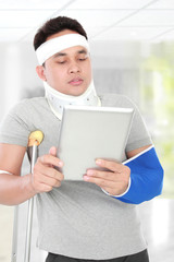 injured young man look serious use the tablet