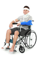 injured young man sit in wheelchair