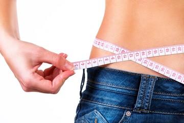 Close up of a girls waist.Weigh loss concept.