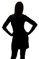Silhouette of woman with hands on hip