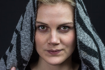 young woman with a scarf as a head scarf