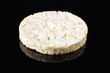 Rice cracker on the black reflective surface