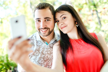 Dating young couple happy in love taking selfie