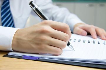 Businessman meeting to take notes