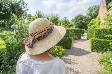 woman in straw hat in garden