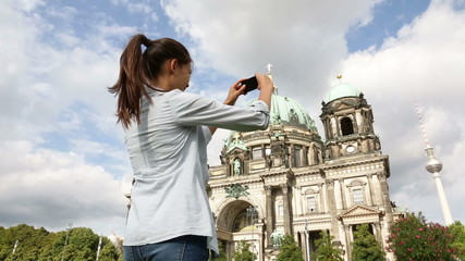 Wall Mural - Travel woman taking photograph in Berlin Germany
