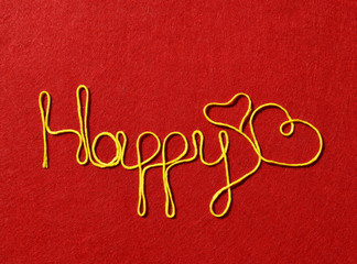 happy ribbon greeting and hearts on red background