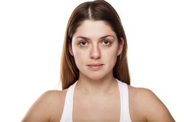 young woman without make-up on white background
