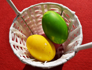 colorful eggs on red background