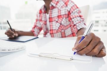 Designer taking notes and using digitizer