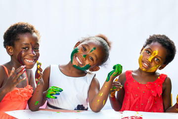 Small African girls showing painted faces