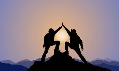 silhouette of 2 men,mountain top ,sunset