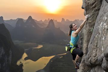 Female climber against sunset at Li River