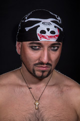 Man as pirate on the black background