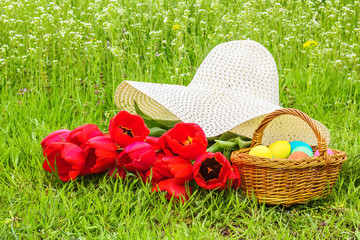 Easter picnic on the spring green meadow