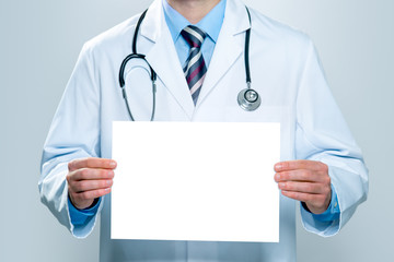 Doctor with a blank white banner