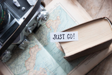 """Just go"" book, map, camera"