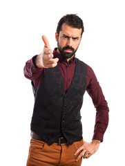 Man wearing waistcoat making gun gesture