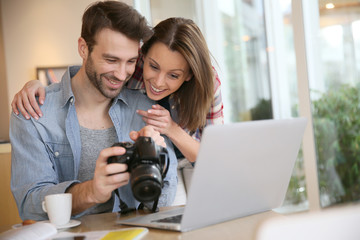 Couple watching photos on laptop computer
