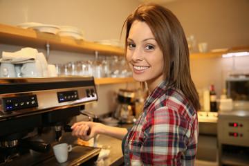 Coffeeshop keeper preparing expresso