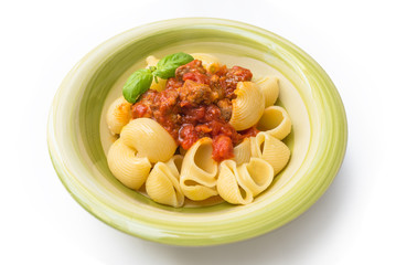Lumache with pork sausage and tomato sauce, italian food