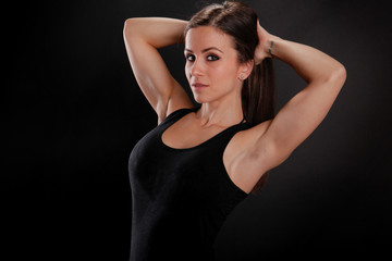 Fit girl stretches her arms