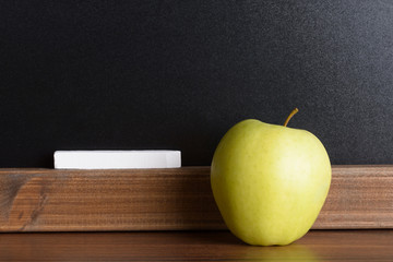 Apple And Chalk In Front Of A Chalkboard