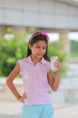 Closeup of young girl drinking milk
