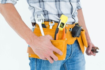 Cropped image of technician with tool belt around waist