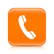 Orange phone button icon with reflection