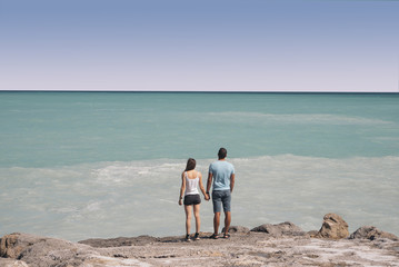 Happy couple on a beach on holidays