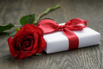 present box with ribbon bow and rose