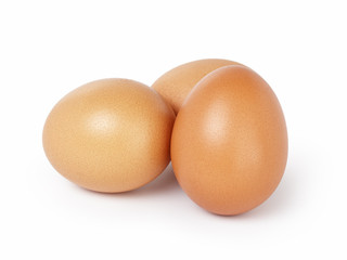 three brown eggs isolated