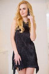 Attractive Blond Woman Using her Mobile Phone