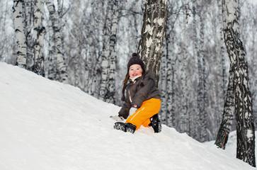 A little girl climbing up on a hill