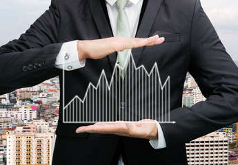 Businessman standing posture hand holding graph finance