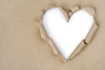 Heart shaped torn through recycled paper