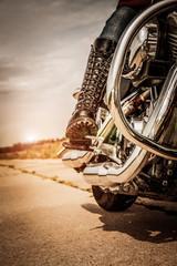 Fototapete - Biker girl riding on a motorcycle