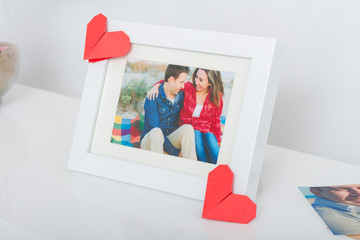 Frame with couple photo and origami hearts
