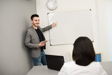 young business man or teacher showing on white board